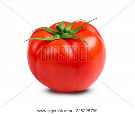 Fresh red tomato on a white background. Red appetizing tomato with a green stalk on a white background.