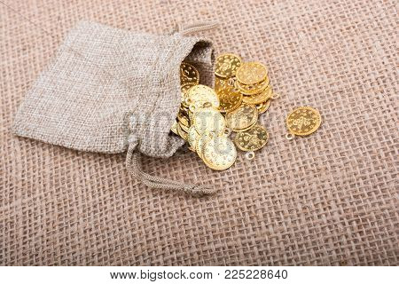 Fake Gold Coins Out Of A Little Sack On Canvas