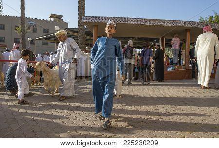 Nizwa, Oman, Febrary 2nd, 2018: Omani Boy At A Traditional Goat Auction