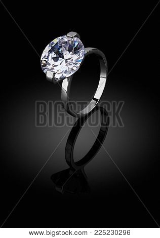 Jewelery ring with diamond on black background, clipping path