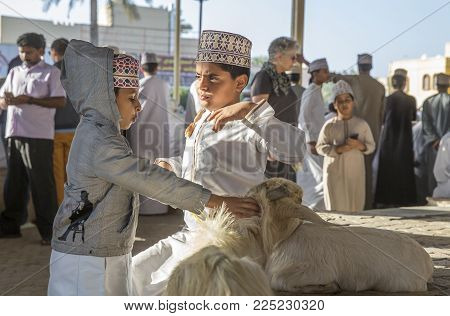 Nizwa, Oman, Febrary 2nd, 2018: Omani Boys At A Traditional Goat Auction