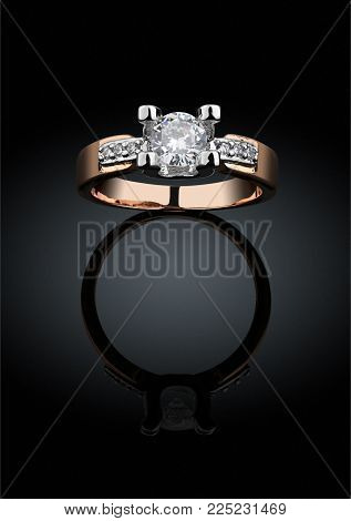 Golden Jewelery ring with big diamond on black background, clipping path