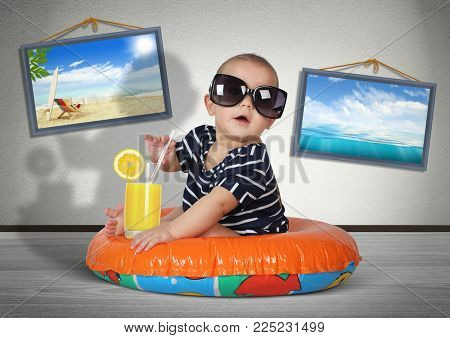Funny child rest on swimming ring at home, as on the beach. Vacation concept