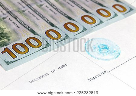 One million dollars out of five hundred dollar bills. A debt document with a blue beatcoin stamp next to the place for the signature. The concept of the agreement on the exchange of crypto-currencies.