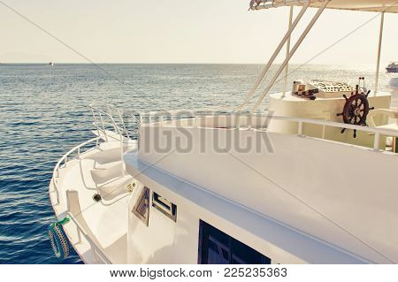 Ship chopping with the rudder in the sun. The place of the captain for control handwheel of the ship.