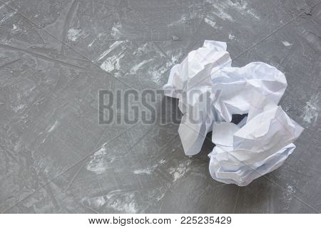 image of crumpled paper on gray concrete table