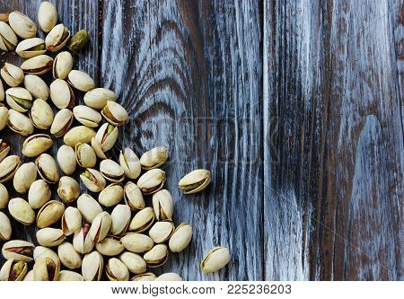 image of pistachios nuts on wooden background