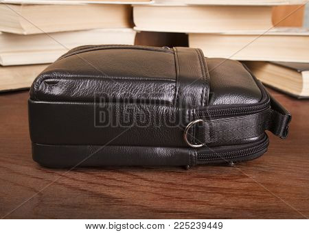 Black Men's Bag; Leather Bag On A Wooden Background