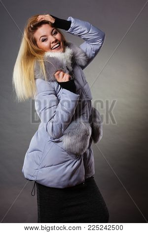 Seasonal fashion, clothes and clothing concept. Woman wearing light winter warm furry coat perfect for cold days