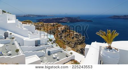 View of volcanic caldera from the terrace of outdoor restaurant in Thira city, capital of Santorini island, Greece