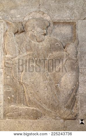 ZAGREB, CROATIA - AUGUST 19: Saint Mark the Evangelist, relief by Ivan Mestrovic, church of St. Mark in Zagreb, Croatia on August 19, 2017.