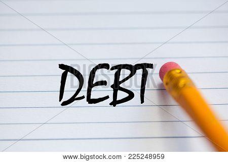 pencil erasing debt written on paper