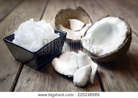 Fresh coconuts and coconut oil cooking ingredient or spa treatment