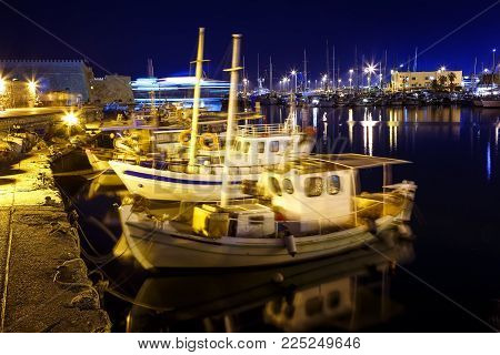 port of Heraklion, Crete, Greece, night , old Fort and ships with yachts