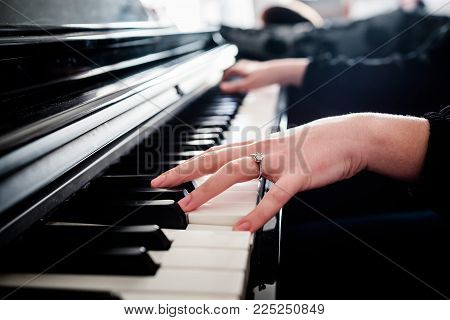 female hands playing piano. electric piano  music instrument