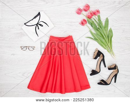 Fashion Concept. Red Skirt, Blouse, Glasses, Black Shoes And Pink Tulips. Top View