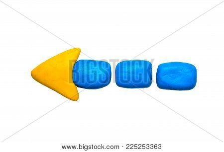 Yellow blue arrow pointer isolated. Modelling clay navigation sign on white background. Dashed arrow kids art. Children hobby modeling. Handmade arrow sign. Presentation arrow point symbol