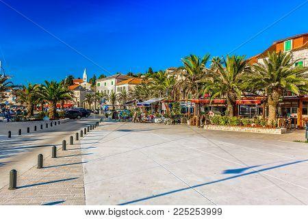 Scenic view at mediterranean promenade in center of town Rogoznica, picturesque tourist resort on Adriatic Coast, Croatia.