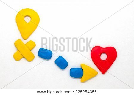 Modelling clay navigation sign on white background. Bright navigation sign isolated. Road signs clipart. Route start and destination pointer.Heart shape pointer. Romantic journey. Road map to love