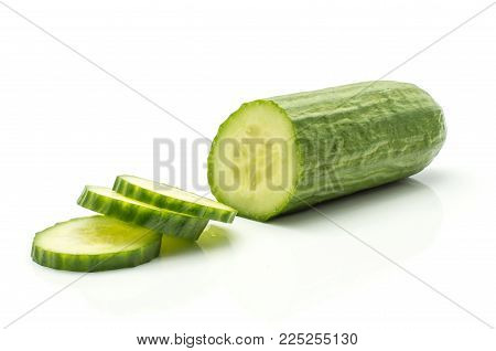Sliced European cucumber half (burpless, seedless, hothouse, gourmet, greenhouse, English) with three round slices isolated on white background