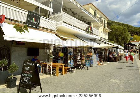 Paxos harbour, Greece - October 01, 2017 : Paxos tourist visiting the small island south of Corfu a Greek island in the Ionian sea