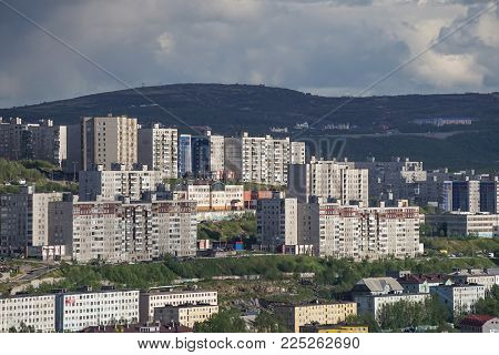 Murmansk, Russia-June 5, 2015: The urban landscape of the Murmansk Soviet architecture and the bright foliage of summer.