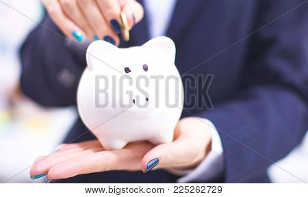 Piggy Bank in hands of a family.