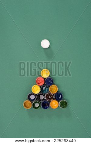 top view of billiard ball with colorful paints on green billiard table