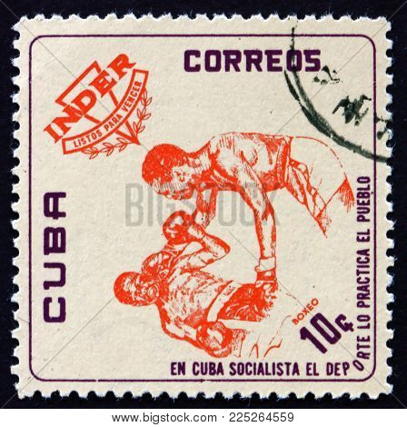 Cuba - Circa 1962: A Stamp Printed In Cuba Shows Boxing, National Sports Institute Emblem And Athlet