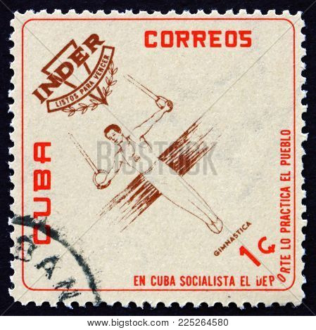 Cuba - Circa 1962: A Stamp Printed In Cuba Shows Gymnastics, National Sports Institute Emblem And At