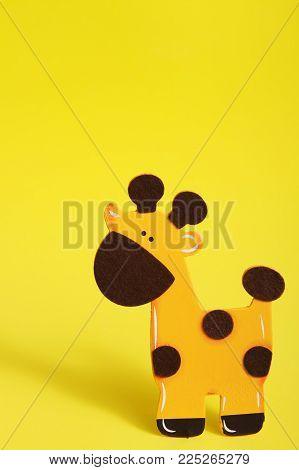 a yellow zoo animal giraffe on yellow background