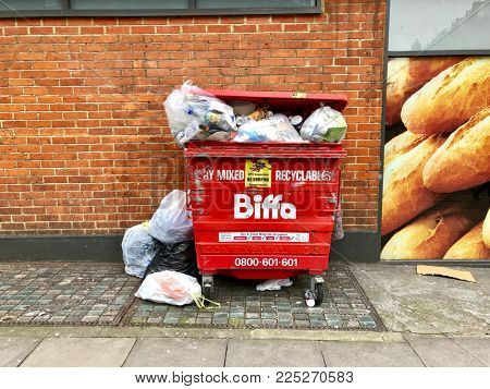 LONDON - FEBRUARY 5, 2018: Recycled waste overflows a bin in West Hampstead, London, UK.