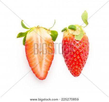 Garden strawberry top view one whole and one cross section half compare isolated on white background
