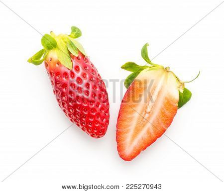 Garden strawberry top view one whole one section half compare isolated on white background