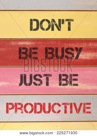 Quotes on be productive, written on colorful wood plank