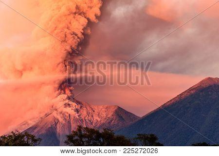 Fuego volcano erupting at dawn next to Acatenango volcano near Antigua, Guatemala, Central America