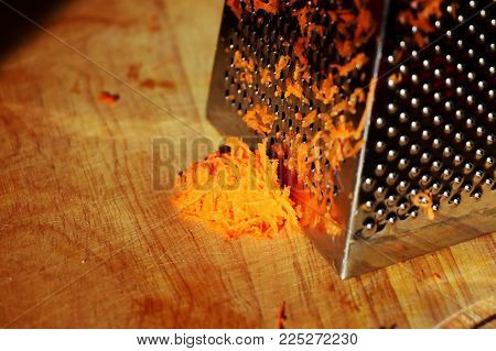The Grated Carrot Leaning On A  Grater