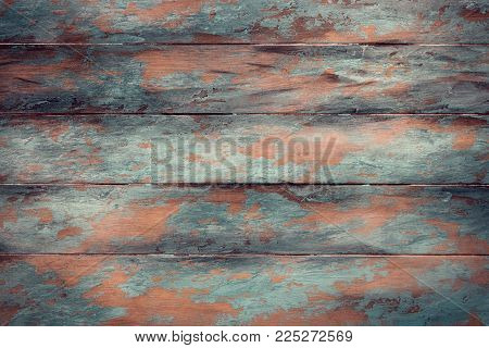 Wooden background with peeling paint, place for text