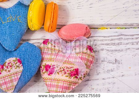 heart of fabric on a background of old white boards to the underlay on the Internet and articles on sweets, holiday concept