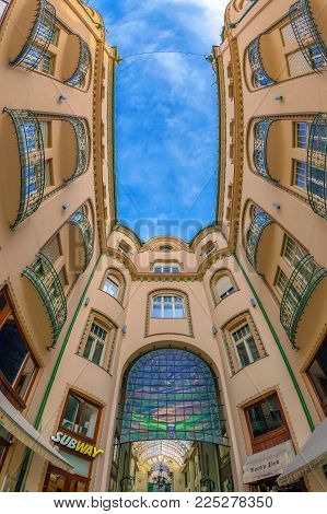 ORADEA, ROMANIA - JANUARY 27, 2018: Principal entrance in the Black Eagle Palace with glass covered passage, landmark of the city.Built between 1907-1908 by the architects Marcell Komor and Odso Jakob