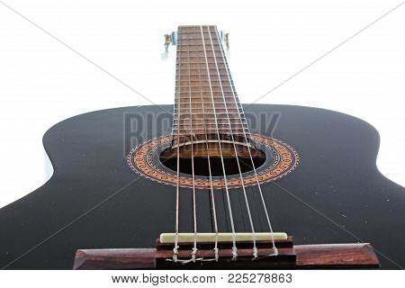 Guitar artsy POV background. Music illustration. Black and white guitar closeup. Photo.