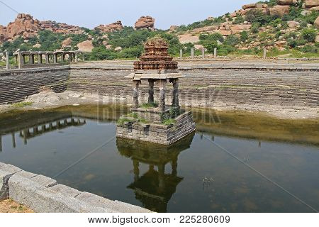 Pushkarani is a sacred lake on the way to the Vitthala temple in Hampi, Karnataka, India. The pond served to the ritual and functional aspects of the temple and life surrounding it. The famous tourist destination from GOA.