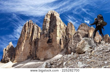 Drei Zinnen or Tre Cime di Lavaredo with hiker, Sextener Dolomiten or Dolomiti di Sesto, South Tirol, Dolomiten mountains view, Italien Alps