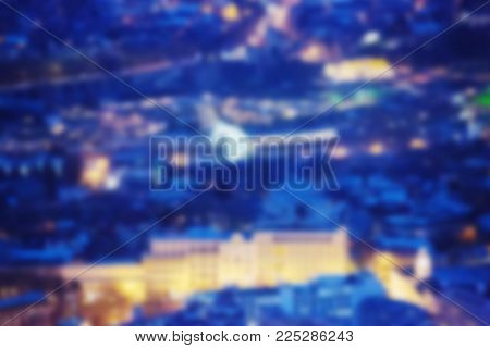 City lights bokeh blur effect at night. Unfocused blurred urban abstract background