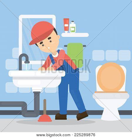 Repair of pipes. Plumber with tools repairing in bathroom.