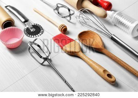 Kitchen utensils for preparing pastries on wooden background