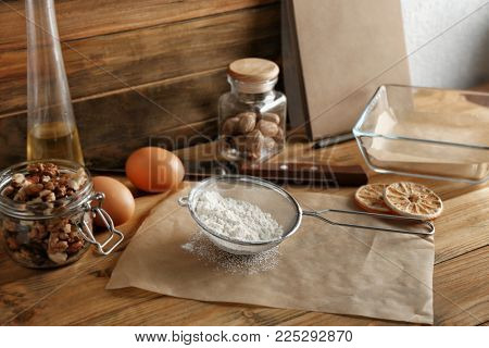 Kitchen utensils and ingredients for preparing pastries on table