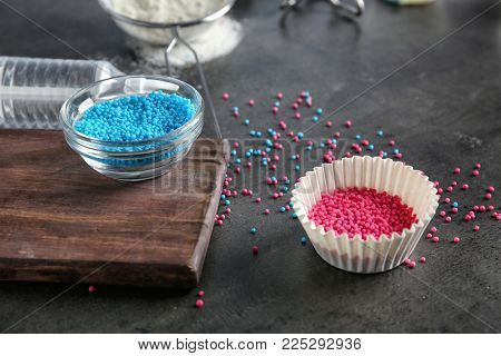 Utensils and ingredients for preparing pastries on grey background