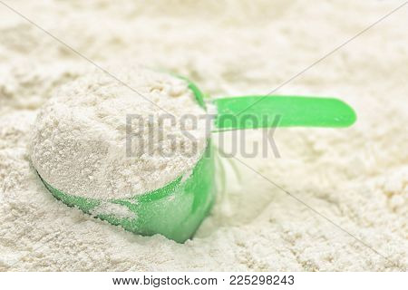 Protein powder with scoop, closeup
