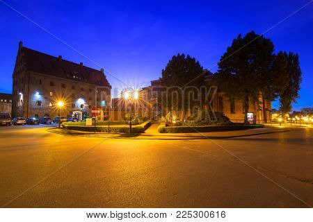 GDANSK, POLAND - JUNE 21, 2017: Architecture of the old town in Gdansk over Motlawa river at night, Poland. Gdansk is the historical capital of Polish Pomerania.